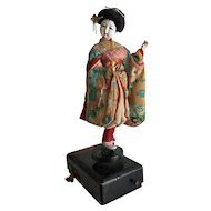 Vintage Japanese geisha dancing doll on lacquer music box