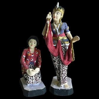 Vintage Javanese dancer penari and singer pesinden figurines wearing sarongs of Surakarta Sultan's Court