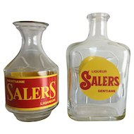 Two French cafe water carafes advertising Salers gentian flower Liqueur