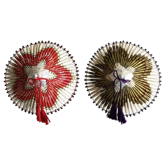 Two vintage origami parasols made from cigarette packages - internment camp art