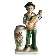 Vintage ceramic man playing guitar with vase - signed EL
