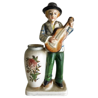 Vintage ceramic man playing guitar with vase - signed EL