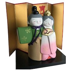 Vintage Heian Hina doll pair on black stand with gold screen byobu