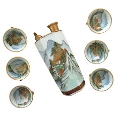 Vintage Kutani Japan whistling sake decanter and 6 whistling cups with mountain scenes