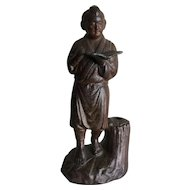 Vintage metal statue of Ninomiya Kinjiro, symbol of thrift, diligence, and hard work in Japan