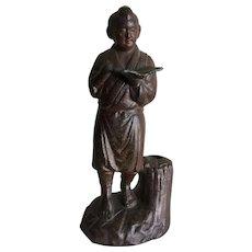 Vintage metal statue of Ninomiya Kinjiro, symbol of thrift, diligence, and hard work in Japan