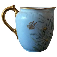 CFH/GDM light blue pitcher with gold handle and rim - daisies and gold butterflies