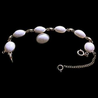 Vintage Egyptian Revival milk glass scarab bracelet and clip-on earrings