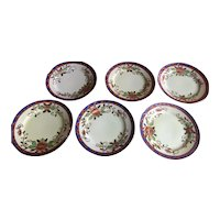 Six vintage made in Japan dessert plates with embossed gilding