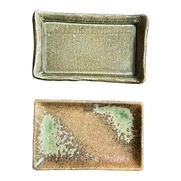 Two vintage handcrafted earthenware Japanese dishes or trays for display - one footed