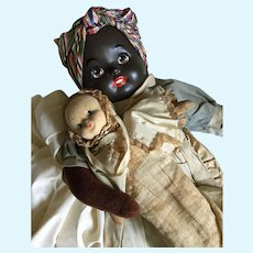 Vintage Black Americana doll with baby doll