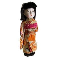 "Vintage 13"" Japanese doll in silk kimono"