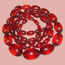 Fabulous CHERRY AMBER Bakelite Elongated Smooth Bead Necklace