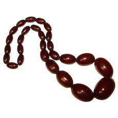Fabulous DARK CHERRY AMBER Bakelite Elongated Smooth Bead Necklace