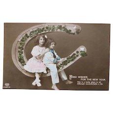 Antique LUCKY New Year Photo Postcard - Clover Shamrocks Horseshoe Girl & Boy