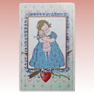 Antique GIRL HUGS DOLL Valentine Postcard - Cupid's Bow & Arrow - Circa 1909