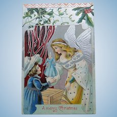 Antique ANGEL GIVES GIRL DOLL Christmas Postcard - With Silver Colored Wings