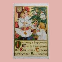 Antique DOLLS ON THE TREE Christmas Postcard - Girl Boy & Baby