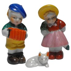 Trio Made in Japan Figurines - Boy in Beret Playing Concertina, Little Girl in Bonnet with Umbrella and a Tiny Dog
