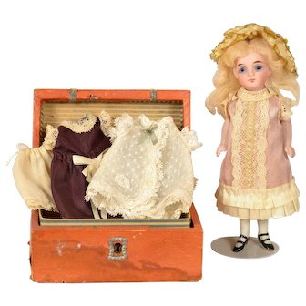 "All Bisque Doll With Trunk of Clothing, 5 1/2"" tall"