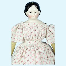 """Early Greiner-Style Hairdo China Head W/ Brown Eyes, 1850, 12 1/2"""" tall"""