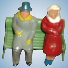 Miniature old couple on a Park Bench Free P&I US buyers