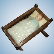 Sweet Miniature Baby in Cradle doll miniature Free P&I US Buyers