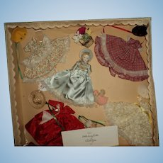 Beautiful Ruth Gibbs China doll Box set 4 outfits Free P&I US Buyers