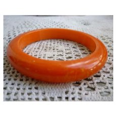 Bright Orange with Yellow Swirls Bakelite Bangle Bracelet