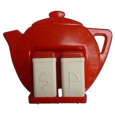 Red and White Plastic Tea Pot Wall Hanger and Salt and Pepper Set