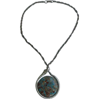 Colorful Disk Framed in Silvertone Ouroboros Necklace