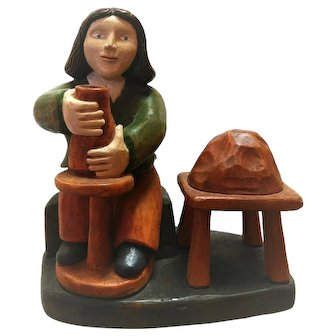 Folk Art Carving of Potter with Wheel