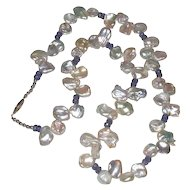 Beautiful White Keshi Pearl Necklace with Natural Tanzanite and Sterling Silver