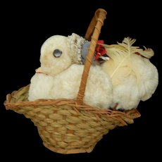 Old chenille chick in antique basket for doll