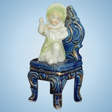 Antique German doll on chair