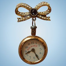 Antique doll watch pin