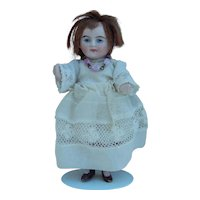 Cute German all bisque doll w/pink stockings