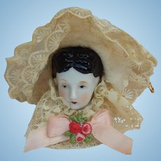 Vintage china head doll ornament