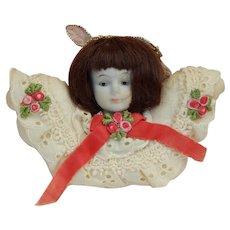 Vintage bisque doll head ornament