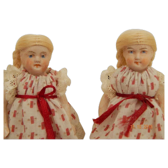 German all bisque twin dolls