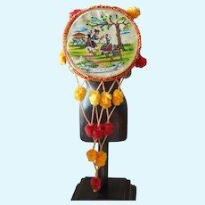 Small old souvenir tambourine for bebe