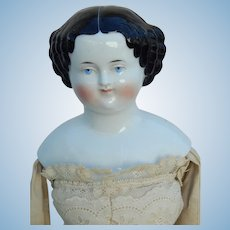 "21"" flat top china with Mona Lisa smile"