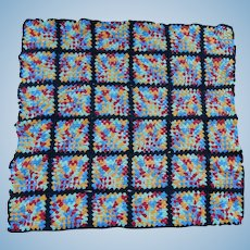 Old granny square coverlet for doll bed