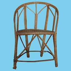 Antique doll's wicker chair w/caned seat