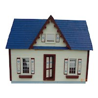 Charming vintage handmade wooden dollhouse