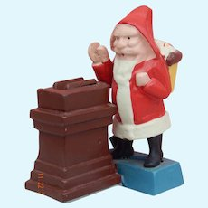 Charming vintage cast iron Santa bank for doll display