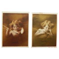Antique miniature sepia prints 'Cupid Awake', 'Cupid Asleep', Taber Prang Art Co.
