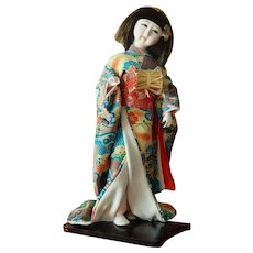 Vintage Japanese geisha doll on wooden base