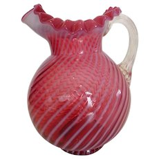 Vintage Fenton Opalescent Cranberry Water Pitcher in Optic Swirl Pattern