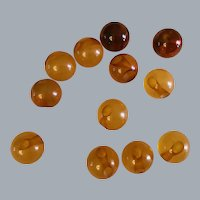 12 Vintage amber coloured glass ball or sphere buttons